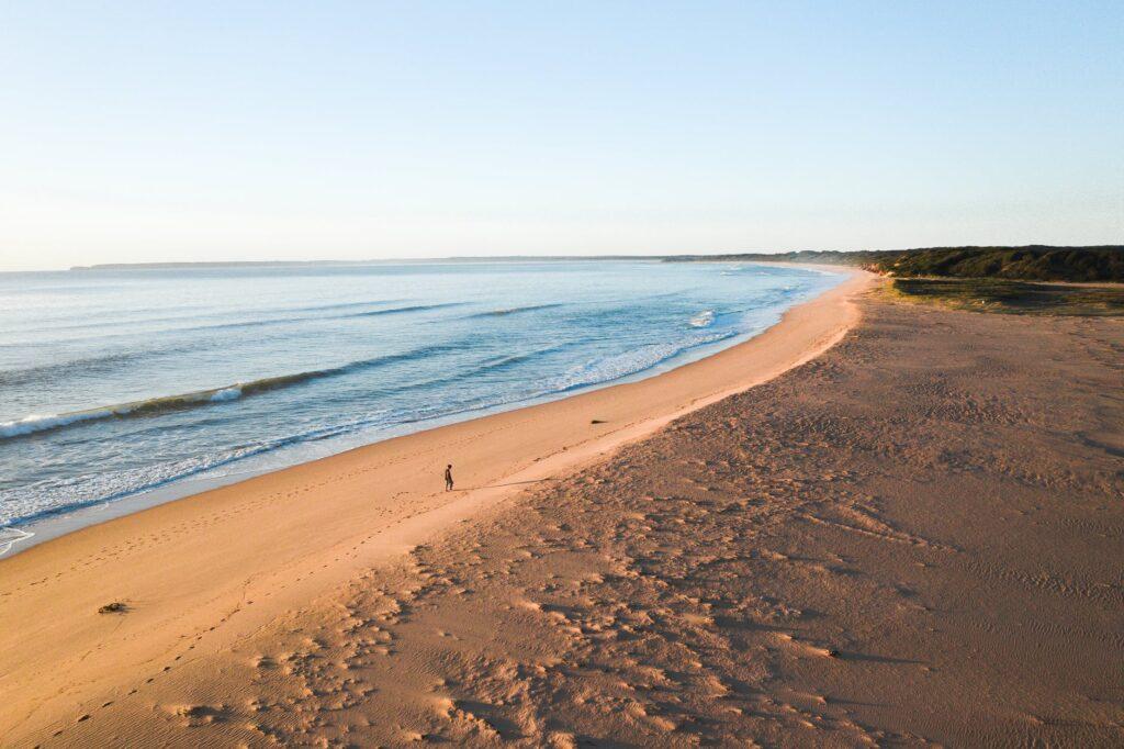 traveler walking near rippling sea